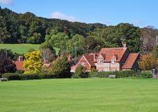 Un paesaggio rurale inglese con Hamlet immagine stock