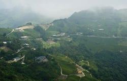 Un paesino di montagna nuvoloso Fotografia Stock
