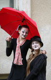 Un pagliaccio delle due ragazze Fotografia Stock