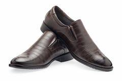 Un paio delle scarpe di cuoio marroni classiche per gli uomini, senza laccetti Immagine Stock