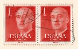 Un paio di vecchi francobolli d'annata rossi con un'immagine di generale franco Fotografia Stock Libera da Diritti