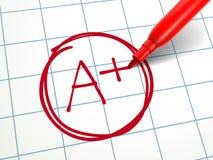 Un papel es más calificado de A con la pluma roja Imagen de archivo libre de regalías