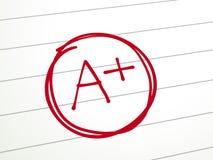Un papel es más calificado de A con la pluma roja Imágenes de archivo libres de regalías