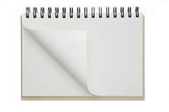 Un papier ouvert de cahier s'est enroulé Images libres de droits