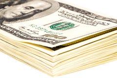 Un paquete de 100 billetes de dólar Foto de archivo libre de regalías