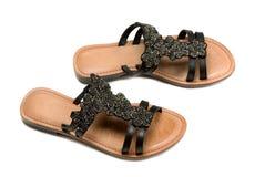 Un par de las sandalias de las mujeres de cuero Foto de archivo