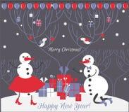 Un par de muñeco de nieve con los regalos de la Navidad Tarjeta de Navidad Fotos de archivo libres de regalías