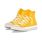 Un par de zapatillas de deporte amarillas Ilustración del vector Foto de archivo