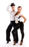 Un par encantador baila en juegos apuestos Imagen de archivo libre de regalías