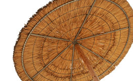 Un paraguas de sol de lámina que simbolizaba vacationing en verano aisló o Fotografía de archivo libre de regalías