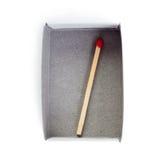 Un partido de madera en la caja aislada sobre el fondo blanco Imagen de archivo libre de regalías