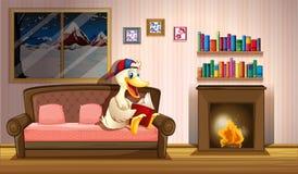 Un pato que lee un libro al lado de una chimenea Foto de archivo
