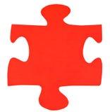 Un pedazo de papel rojo de rompecabezas Foto de archivo libre de regalías