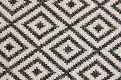 Un pedazo de tela blanco y negro en Rhombus Tela, textura, Fotos de archivo libres de regalías