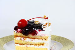 Un pedazo de torta de la cereza Imágenes de archivo libres de regalías