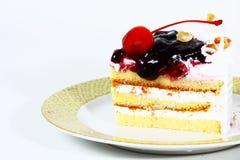 Un pedazo de torta de la cereza Imagenes de archivo