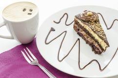 Un pedazo de torta y de café Foto de archivo libre de regalías