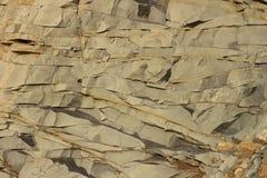 Un pedazo texturizado hermoso de roca como un fondo o textura Foto de archivo libre de regalías