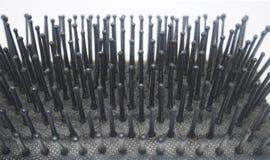 Un peine sucio del cepillo con cierre para arriba Fotografía de archivo libre de regalías