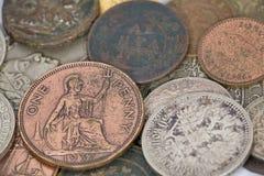 Un penny e vecchie monete Immagini Stock Libere da Diritti