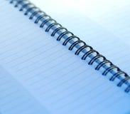 Un pequeño cuaderno espiral Imagen de archivo libre de regalías