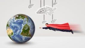 Un pequeño hombre de negocios en un vuelo del cabo del super héroe hacia un globo minúsculo de la tierra con los cometas del Libr Fotos de archivo