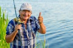 Un pescador feliz Imagenes de archivo