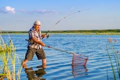 Un pescador y una captura Foto de archivo libre de regalías