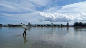 Un pescatore Fotografie Stock