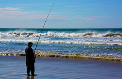 Un pescatore all'oceano Meridionale Fotografia Stock