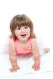 Un petit bébé mignon regarde fixement vers le haut Photo libre de droits