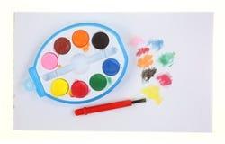 Éclaboussures réglées de brosse de peinture de jouet Photographie stock libre de droits