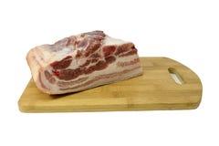 Un pezzo di carne cruda sul tagliere Fotografia Stock