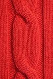 Un pezzo di tricottare maglione arancio Immagini Stock Libere da Diritti