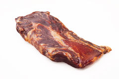Un pezzo solo della carne suina affumicata Fotografia Stock Libera da Diritti