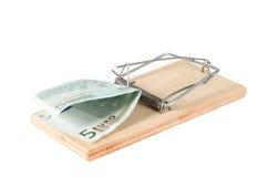 Un piège de souris avec l'argent Image stock