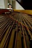 Un piano e un pianista Fotografia Stock