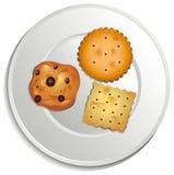 Un piatto con i biscotti royalty illustrazione gratis