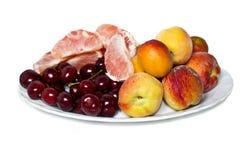 Un piatto con i frutti Fotografie Stock Libere da Diritti