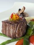 Un piatto del pranzo con bistecca e le verdure bollite Fotografie Stock