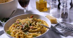 Un piatto delizioso del carbonara degli spaghetti Fotografia Stock