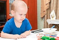 Un piccolo bambino ha fatto un fronte Immagine Stock Libera da Diritti