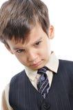 Un piccolo bambino sveglio in vestito di affari fotografia stock libera da diritti