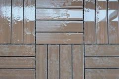 Un piso de madera mojado Imágenes de archivo libres de regalías