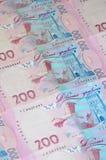 Un plan rapproché d'un modèle de beaucoup de billets de banque ukrainiens de devise avec une parité du hryvnia 200 Fond d'image s Photos libres de droits