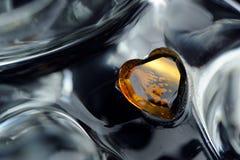 Coeur en verre jaune de la figurine en verre Image libre de droits