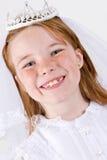 La première communion de la jeune fille Image stock