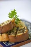 Un plat de pain grillé attend pour être mangé à un restaurant fin image stock