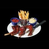 Un plato de la comida de las costillas foto de archivo