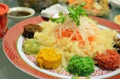 Un plato especial durante Año Nuevo chino llamó Yusheng o a Yee Sang Fotos de archivo libres de regalías